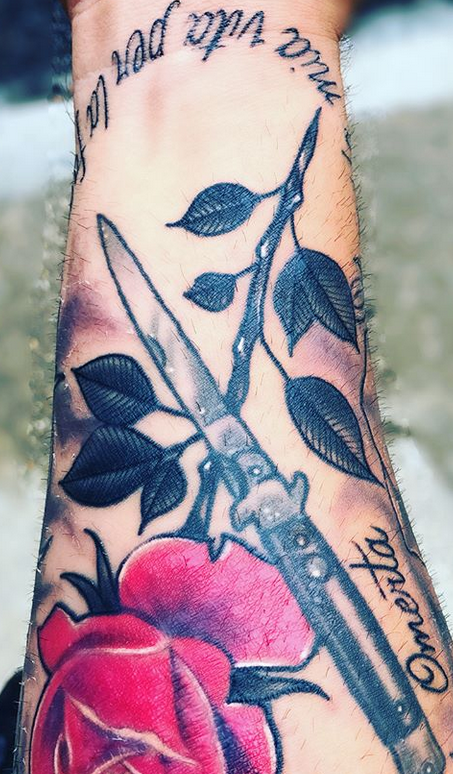 Andrade tattoo Omerta.PNG
