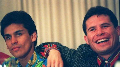 Lopez (left) with Julio Cesar Chavez.