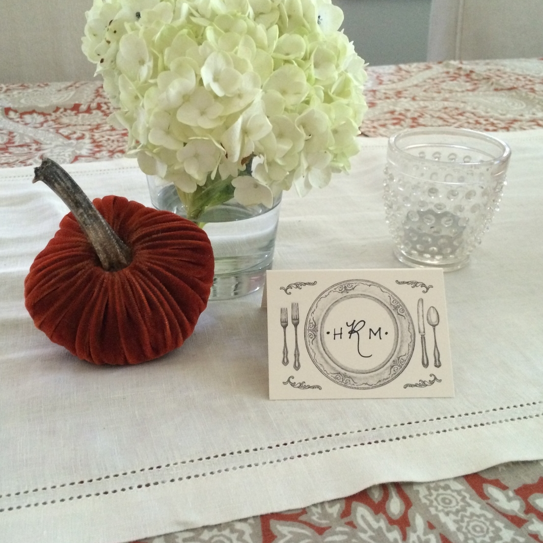Elegant paper-printed place cards with guest's initals.