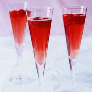 Raspberry Champagne Cocktail – Any type of champagne libation is a hit at the holidays.  Serve this yummy creation at your holiday party!