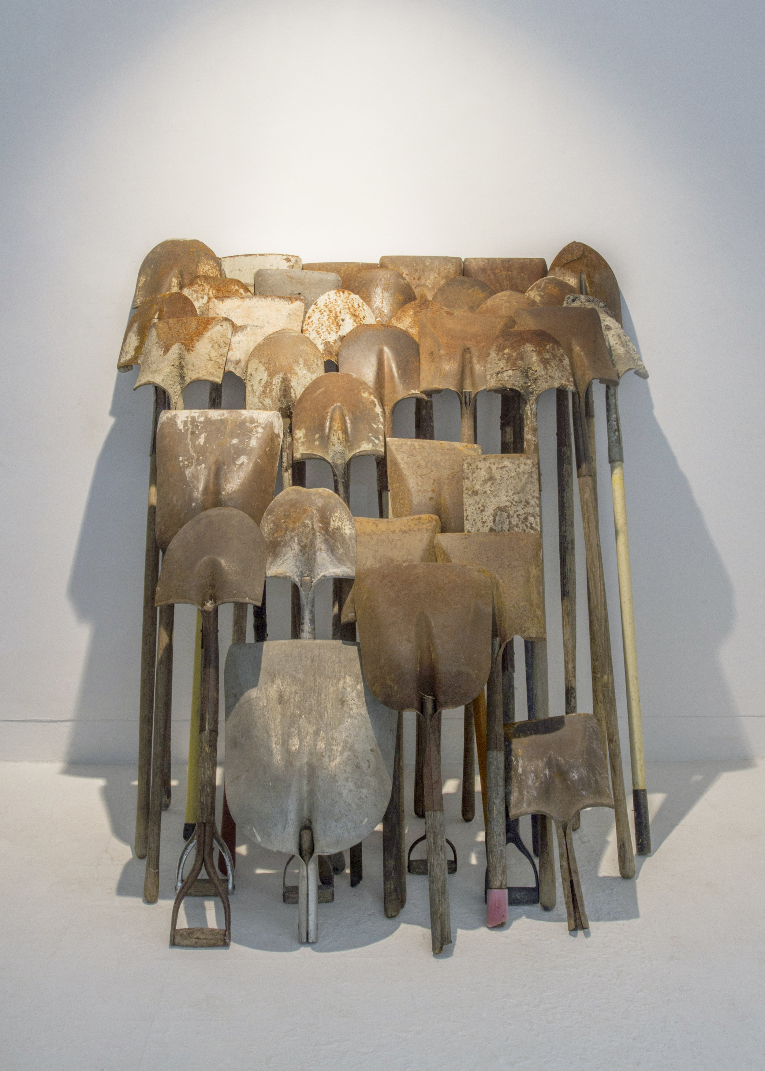 Untitled (palas) —    4' x 5' installation — discarded labor tools