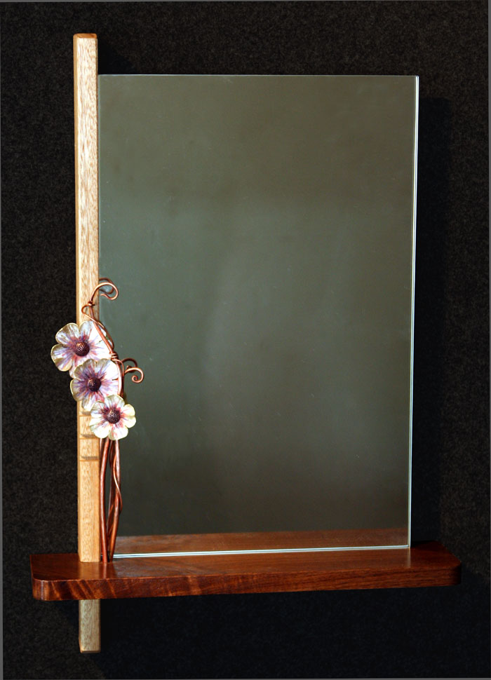 "Mirror with flowers left. 24""h x 16""w x 3.5""d. Walnut, blonde mahogany, copper, brass, 1/4"" plate mirror"