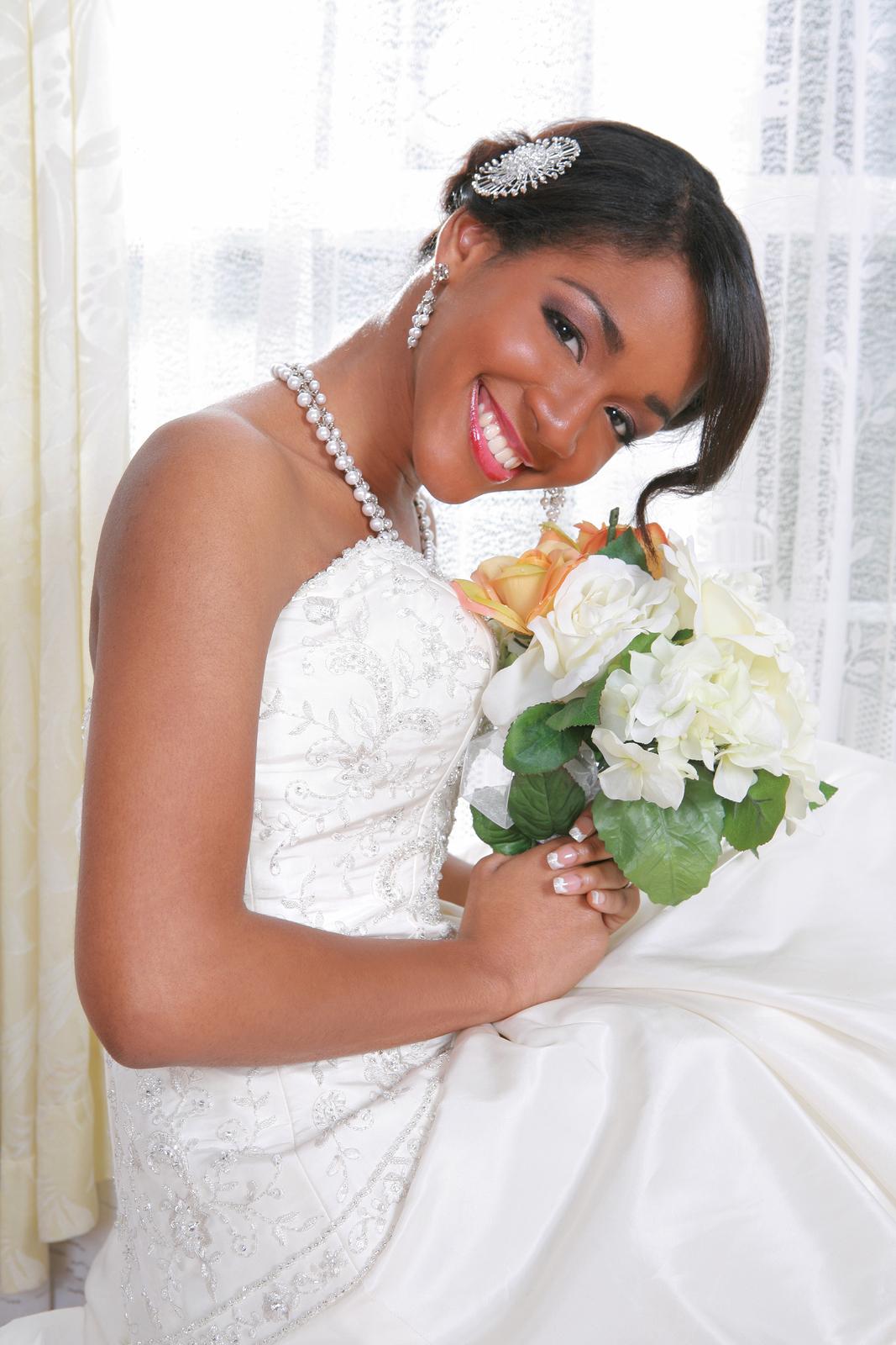 bigstock-Beautiful-Young-Bride-Sitting--4480531.jpg