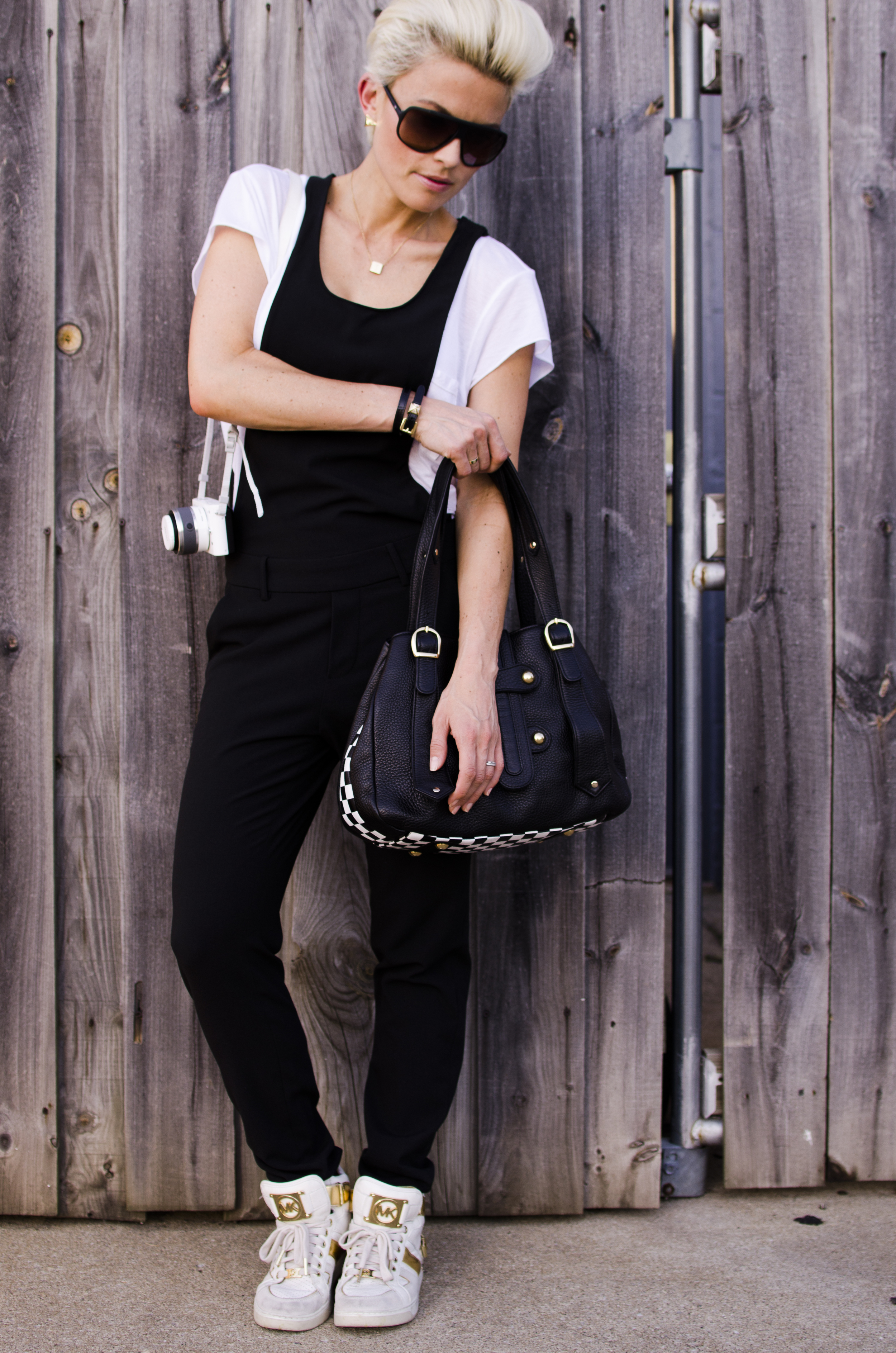 Photos by  @otbp1973     Overalls from ASOS/ T Shirt from William Rast/ Shoes and bracelet from Michael Kors/ Sunglasses from  Gatorz Vizion / Bag from  Tracy Zych / Earrings from  Amy Kirchen Boutique / Necklace from  Aquinnah Jewelry