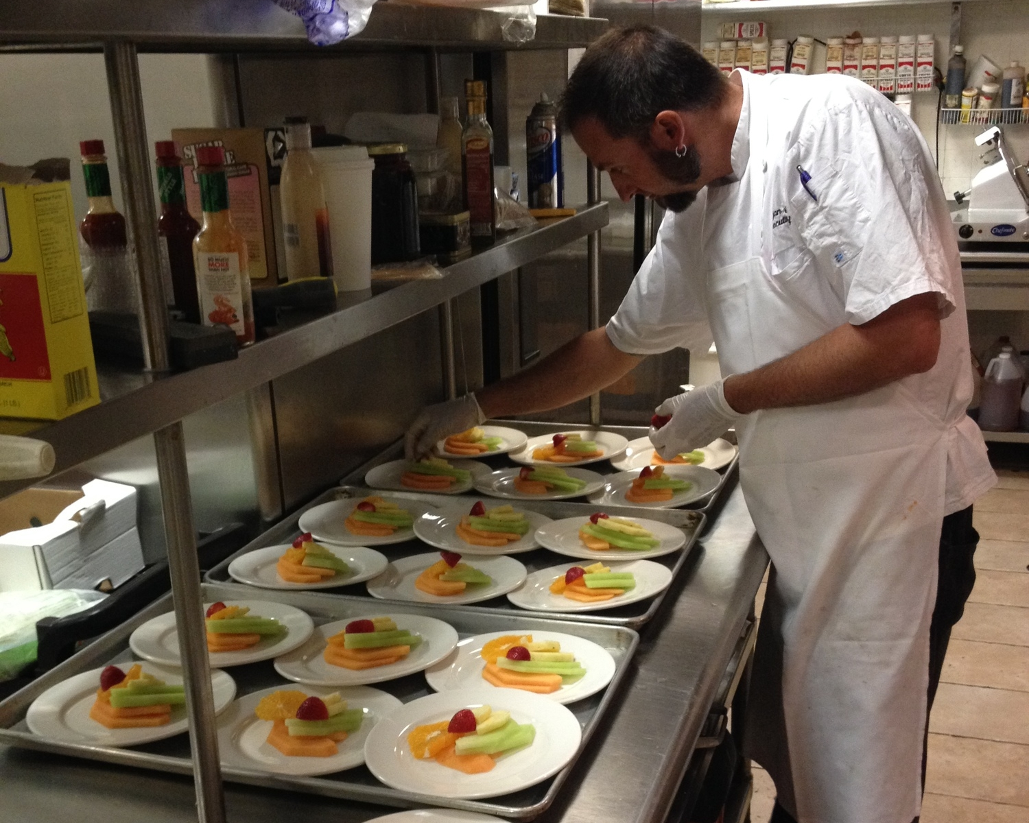Executive Chef Bryan Tomko preparing a Fruit Plate Dessert
