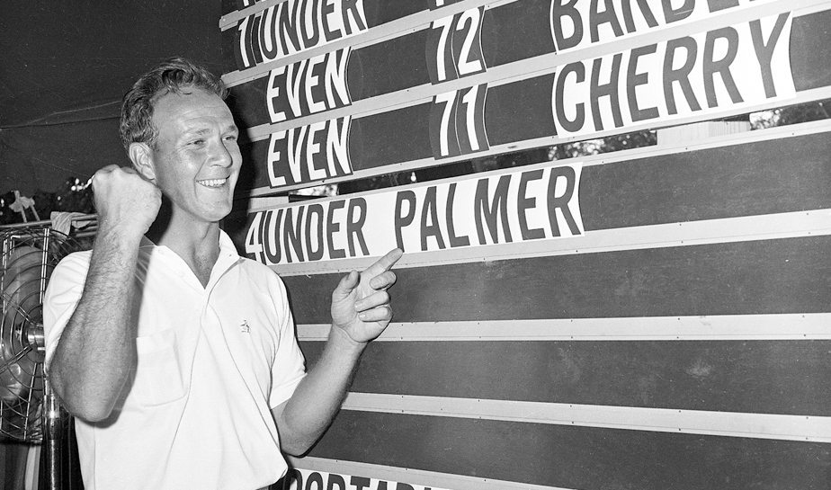 Arnold Palmer points to his name on the leader board at the 1960 U.S. Open tournament in Denver, Colorado on June, 19, 1960. Palmer won the tournament with a score of 280.