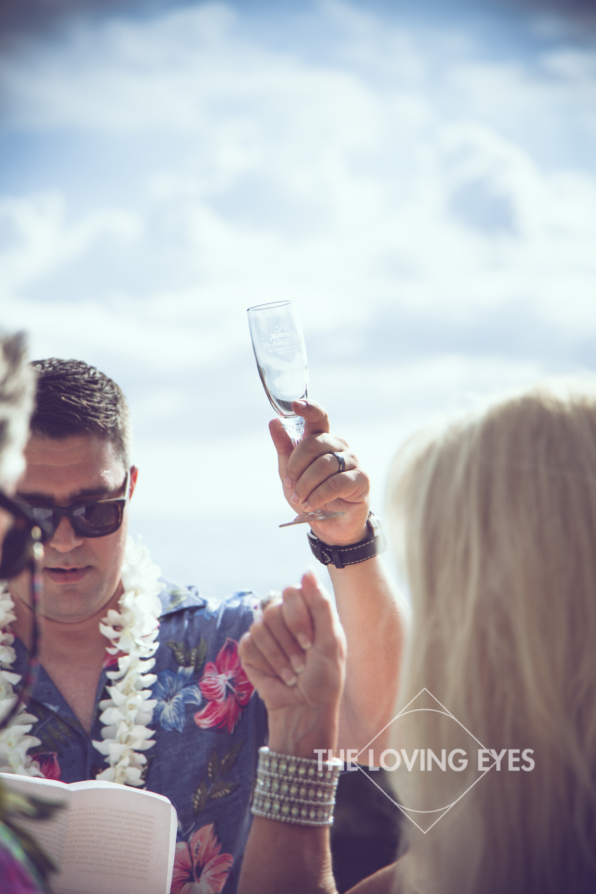 Toast during vow renewal ceremony on the beach at Ko Olina Four Seasons Lagoon