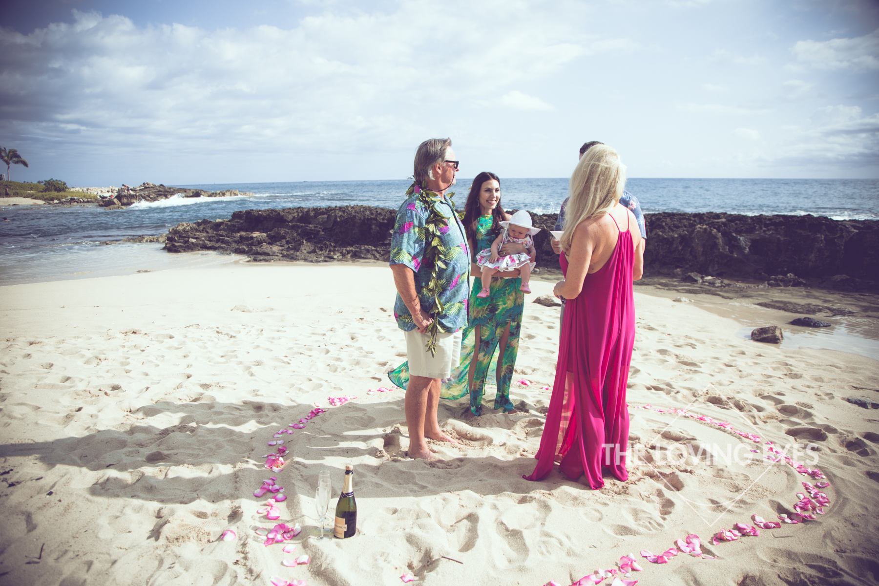 Vow renewal ceremony on the beach at Ko Olina Four Seasons Lagoon