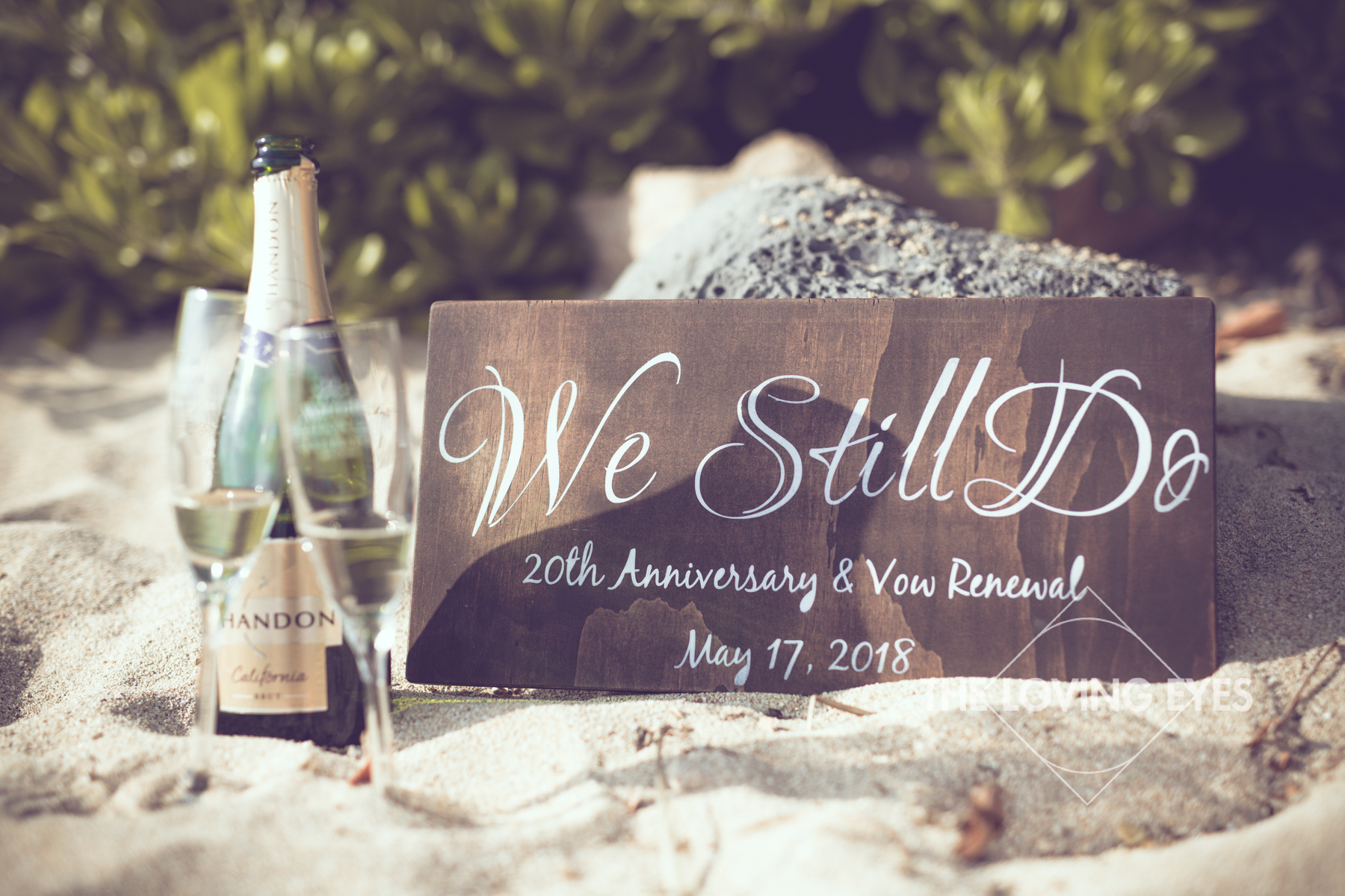 Champagne glass and signage for a vow renewal ceremony on the beach at Ko Olina Four Seasons Lagoon