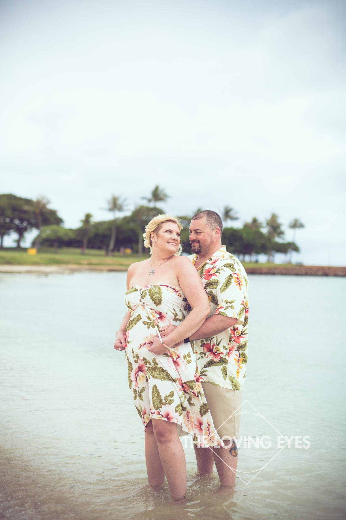 Having fun together on the beach during Hawaii vacation at Ala Moana Beach Park