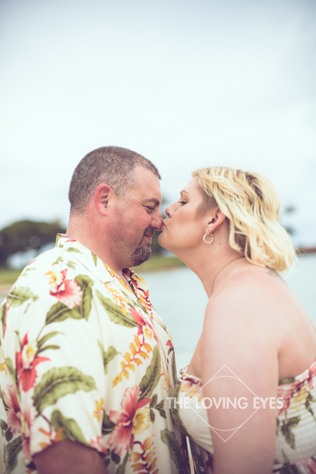 Kissing on the beach during Hawaii vacation at Ala Moana Beach Park