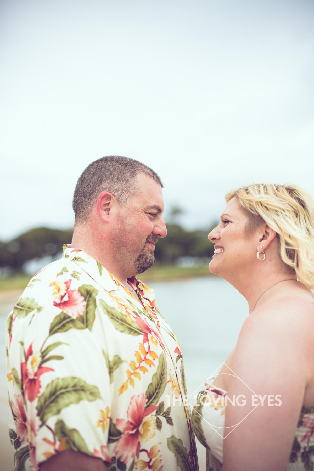 Couple portrait on the beach during Hawaii vacation at Ala Moana Beach Park