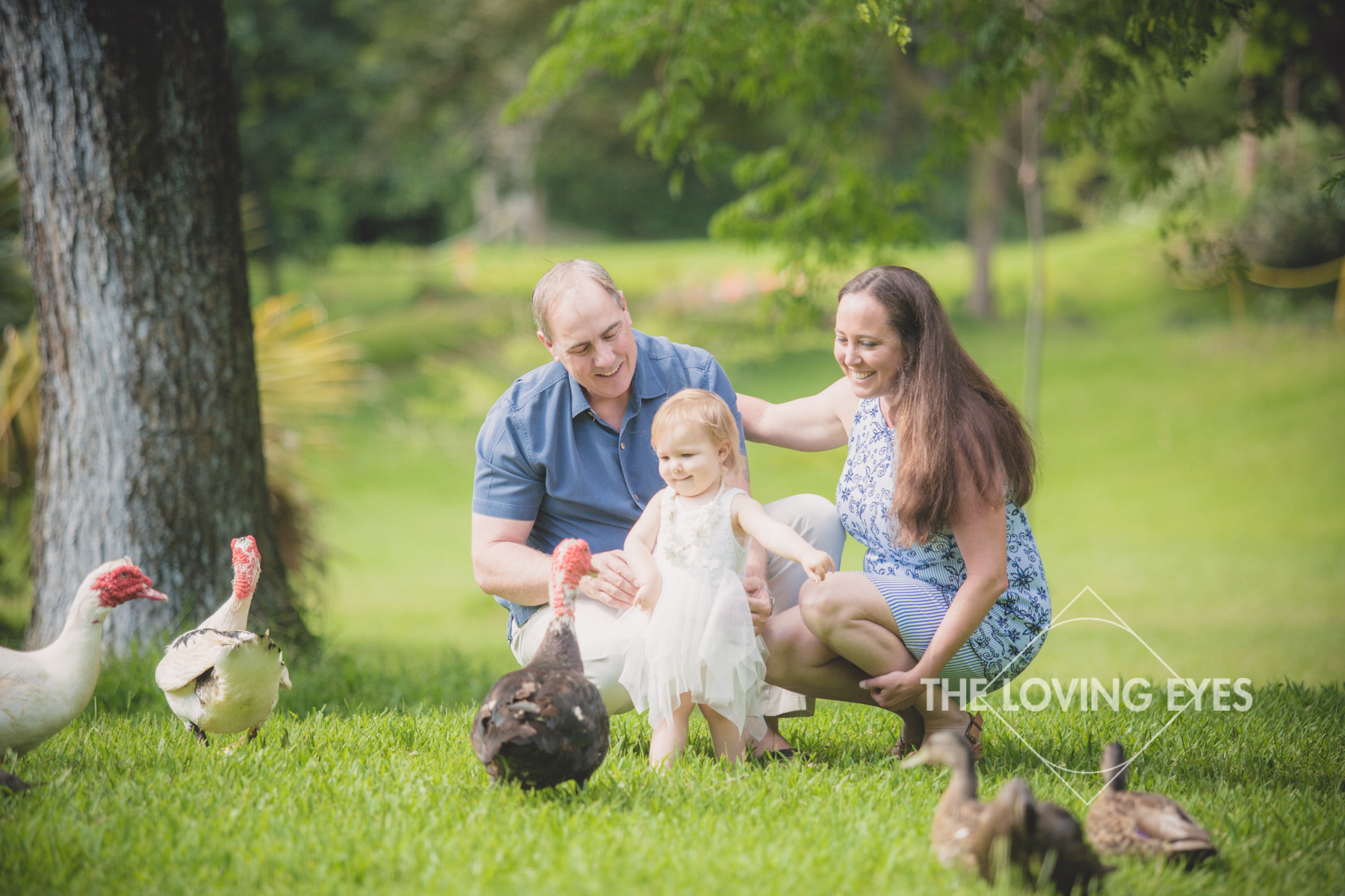 Family portrait during family vacation with ducks and geese at Hoʻomaluhia Botanical Gardens