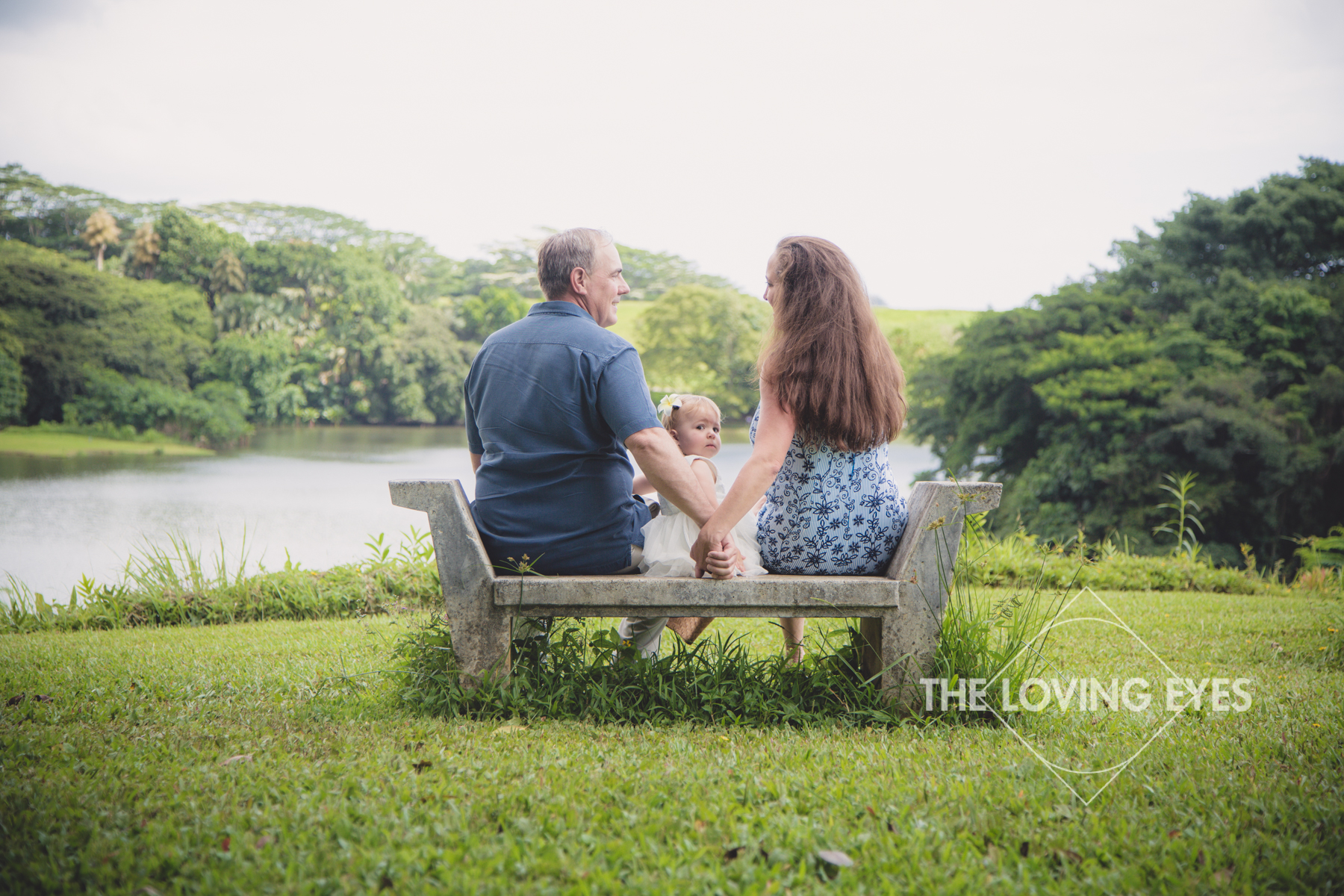 Family portrait overlooking the lake in Hawaii at Hoʻomaluhia Botanical Gardens
