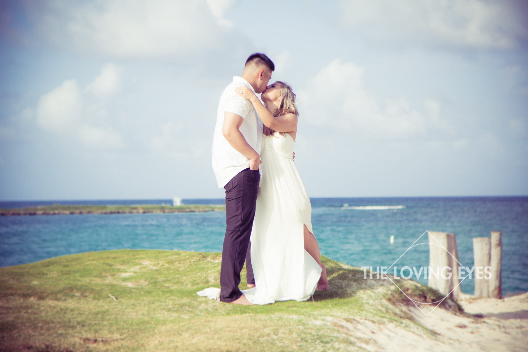 Couple kissing during Hawaii engagement photography on Kailua Beach