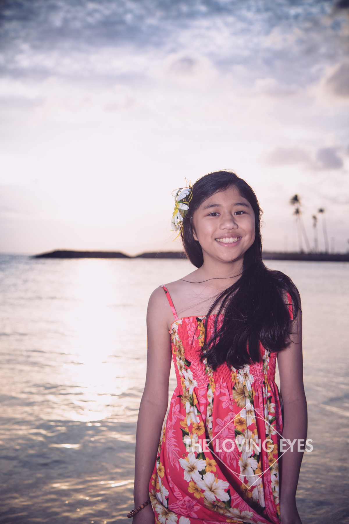 Child portrait on the beach during sunset at Ala Moana Beach Park in Hawaii