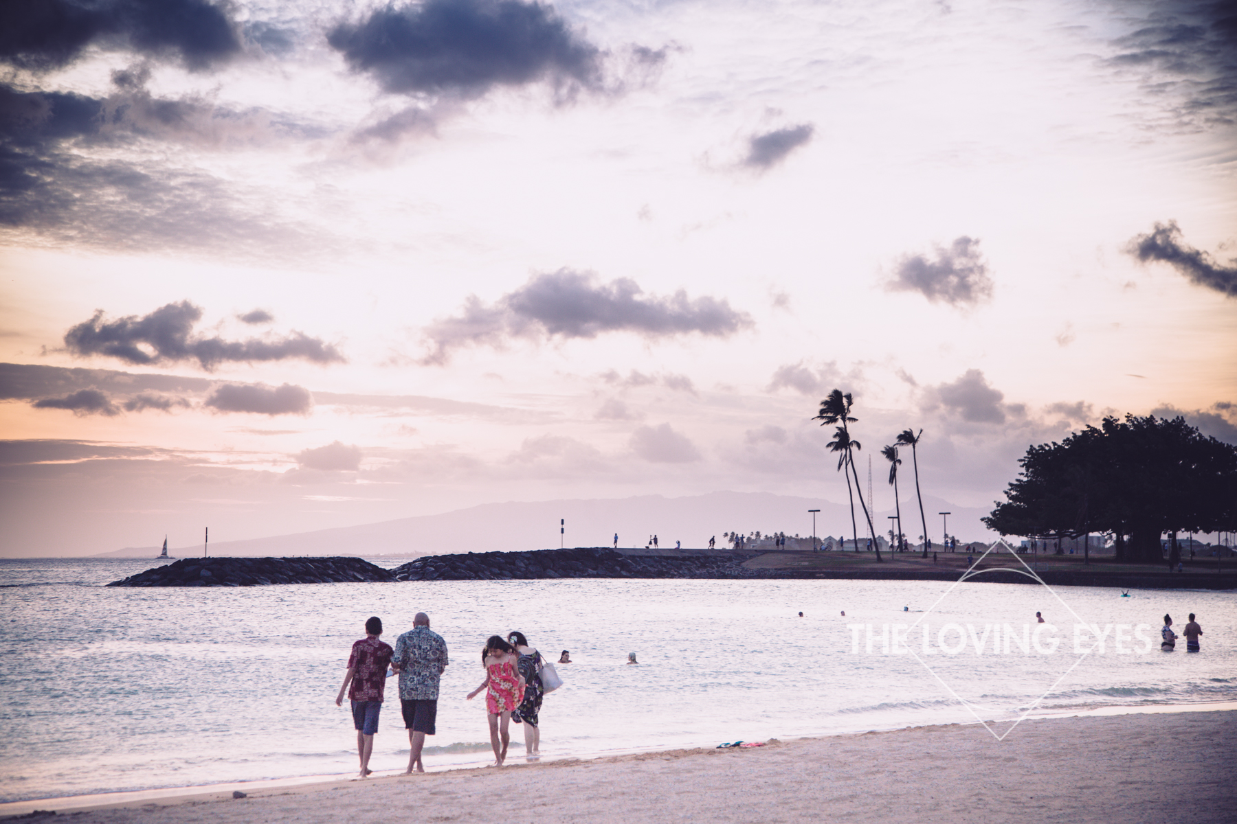 Family vacation portrait on the beach during sunset at Ala Moana Beach Park in Hawaii