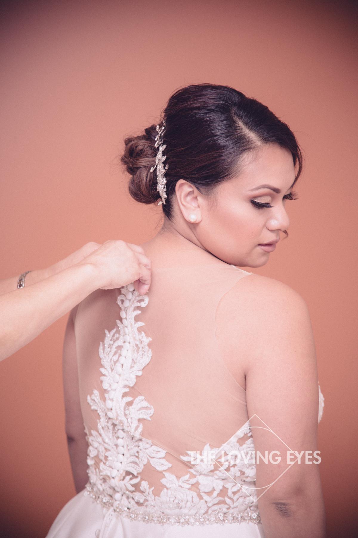Bridal portrait getting ready in wedding dress