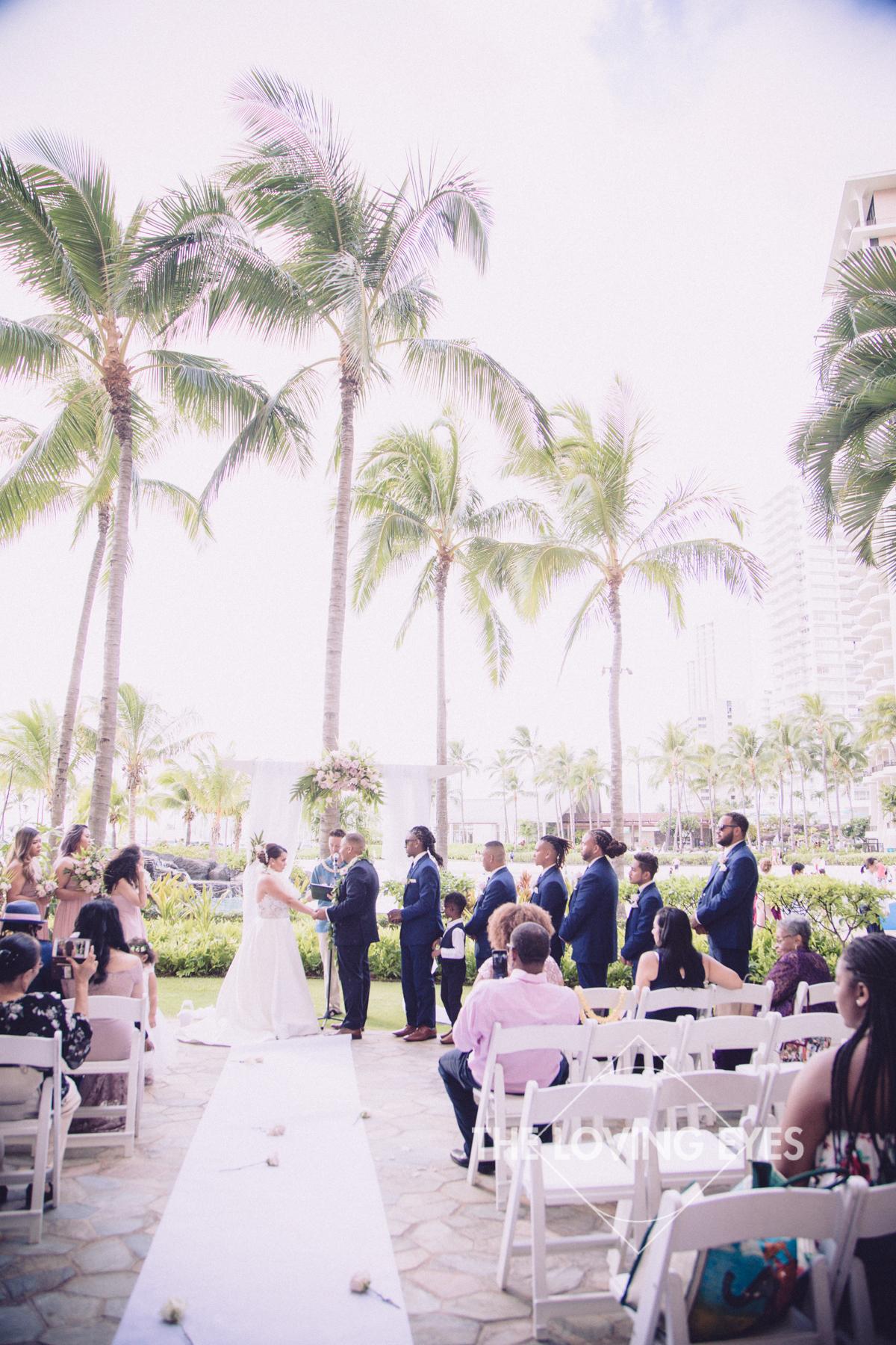 Bride and Groom during wedding ceremony at Hilton Hawaiian Village Rainbow Suite in Waikiki