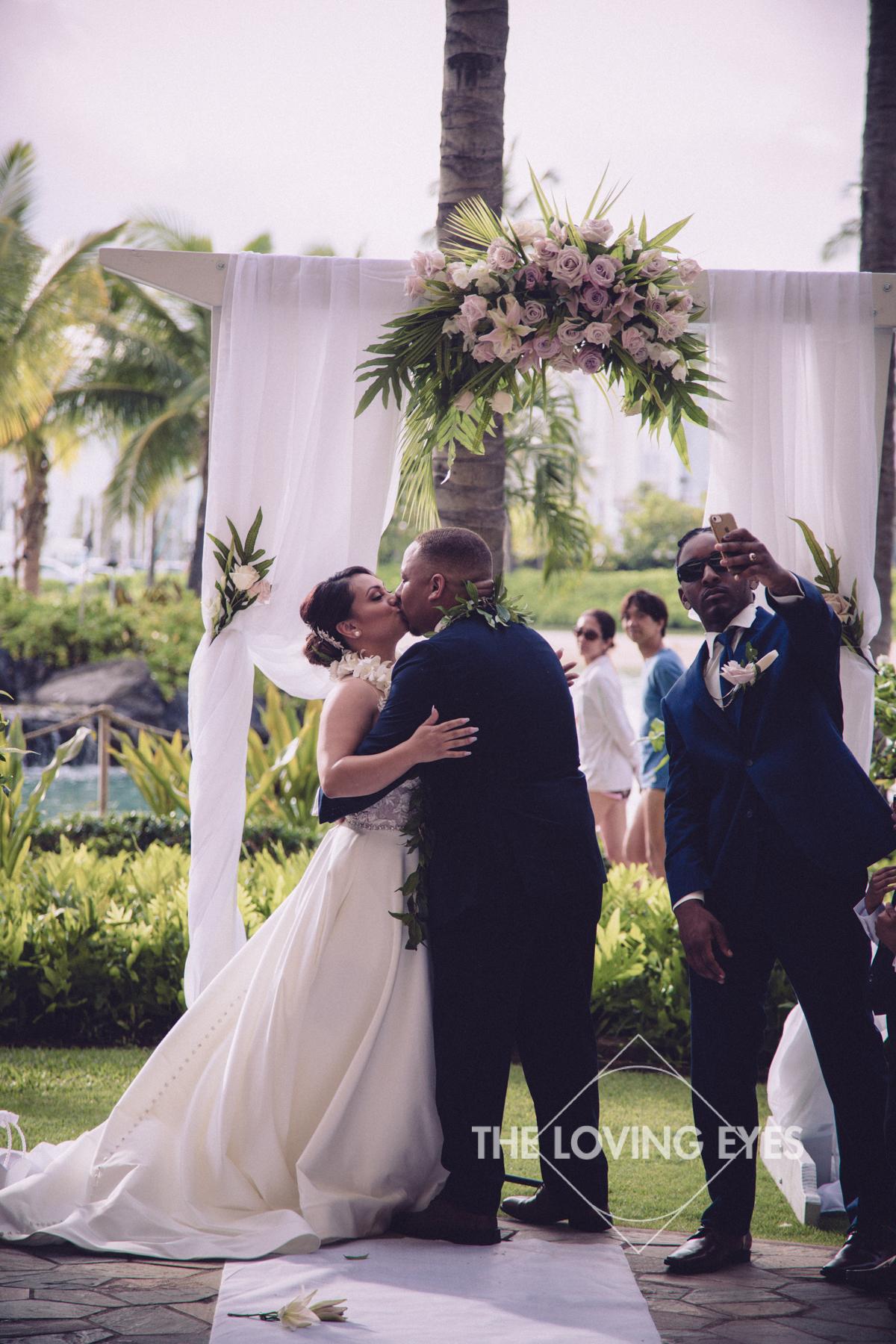 First Kiss during wedding ceremony at Hilton Hawaiian Village Rainbow Suite in Waikiki