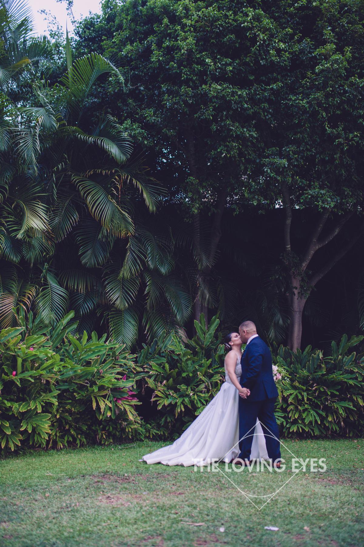 Bride and Groom on wedding day at Hilton Hawaiian Village Rainbow Suite in Waikiki