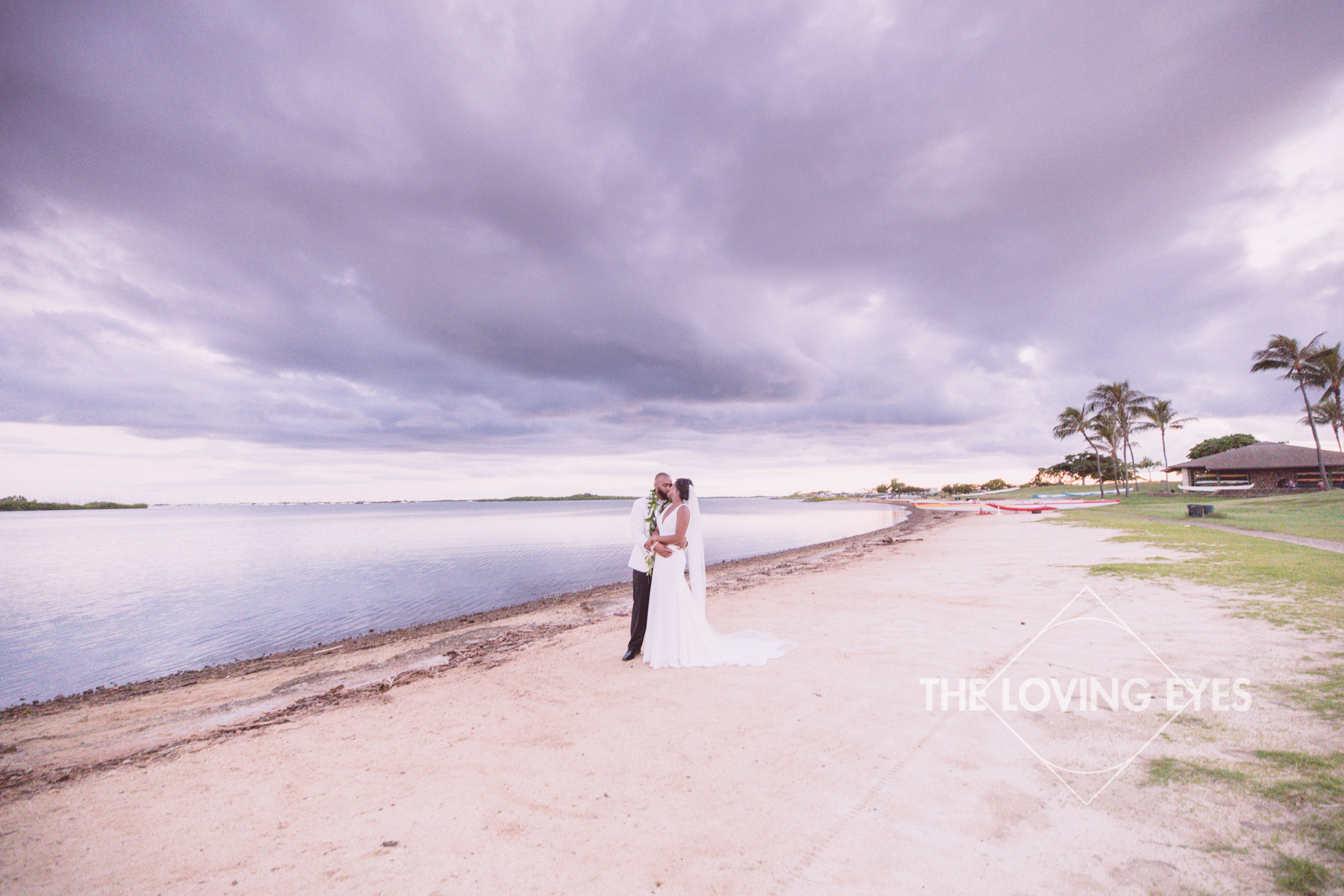 Bride and Groom during sunset on the beach at the Hanalani Chapel in Hawaii