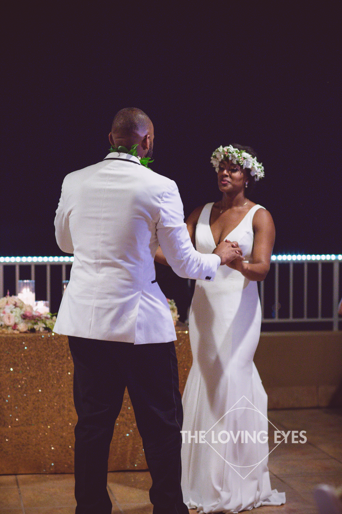 Bride and groom first dance during their wedding reception at Tikis in Waikiki