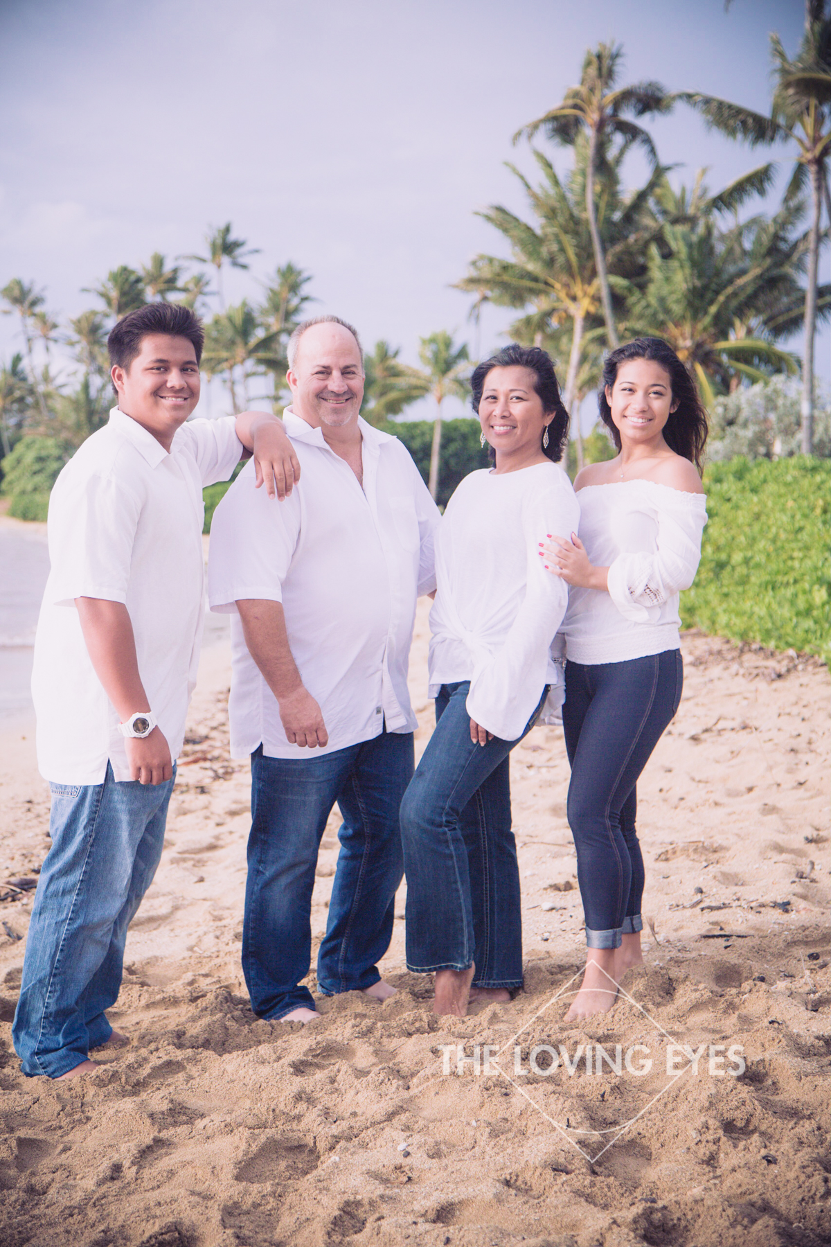 Family portrait on Kahala beach in Hawaii