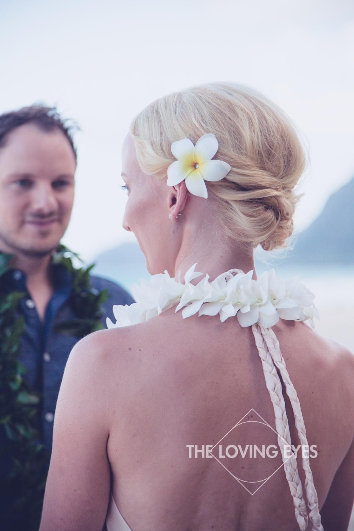 Plumeria flower in hair on Hawaiian beach elopement