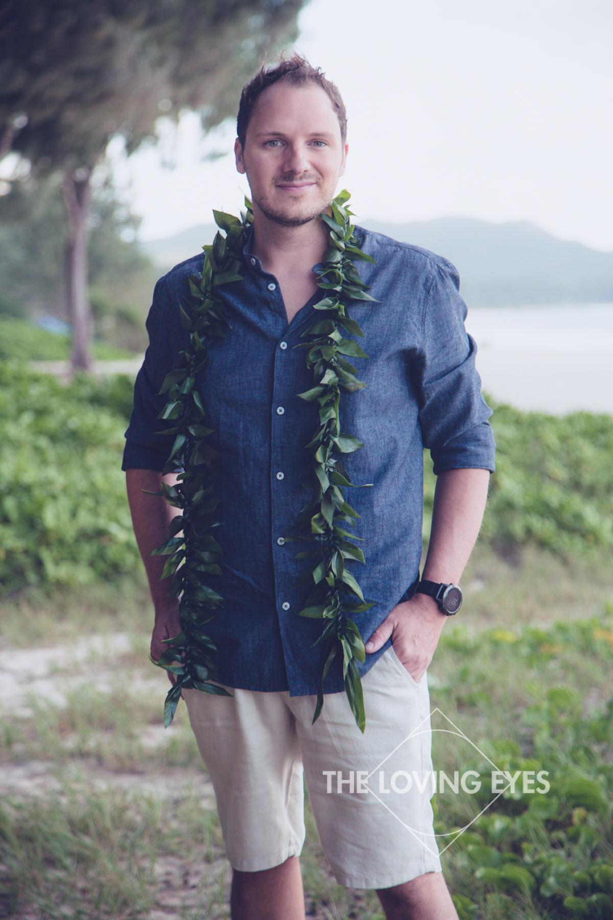 Stunning groom with lei on the beach in Hawaii