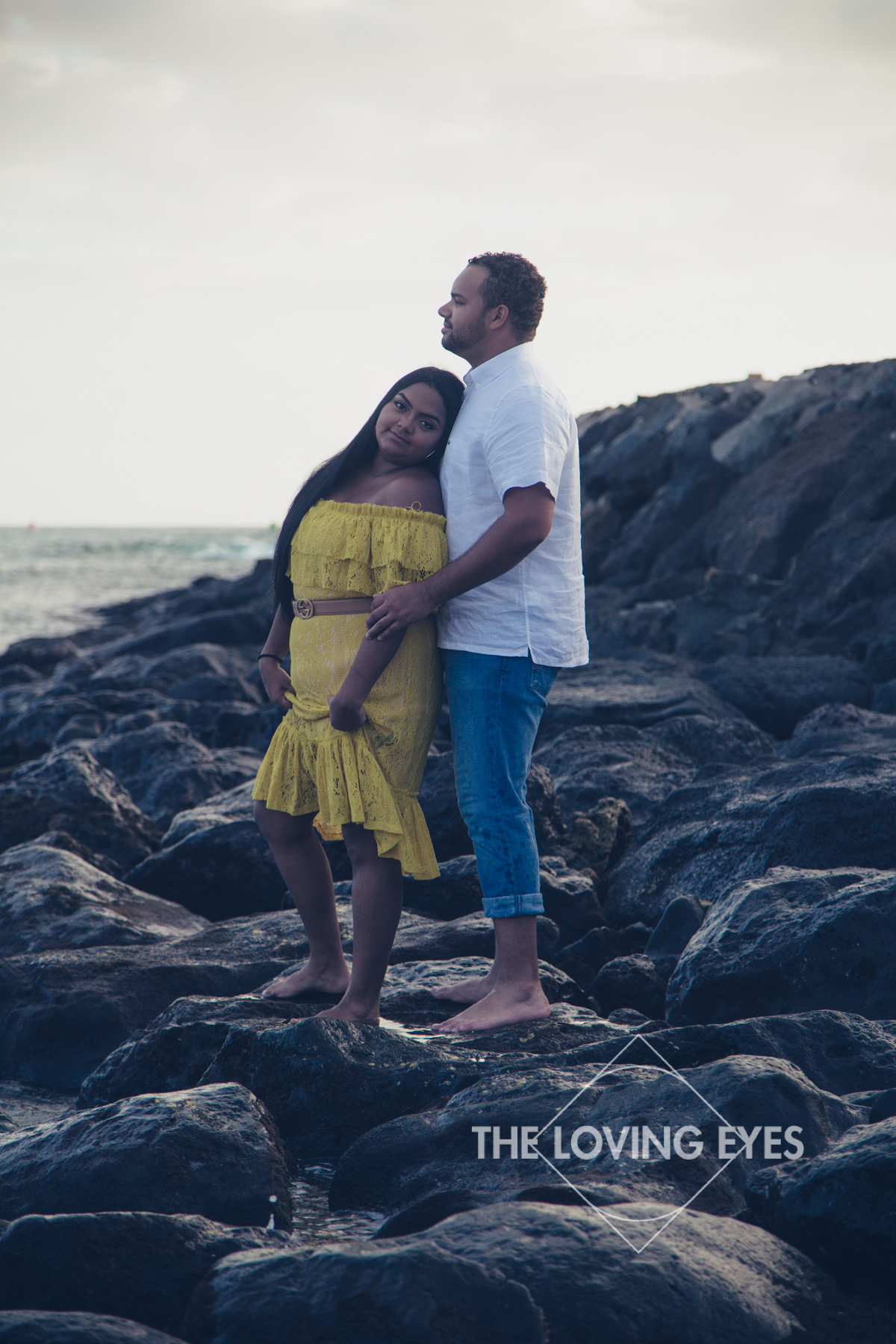 Romantic Hawaii engagement photo on the beach at Ala Moana Beach Park