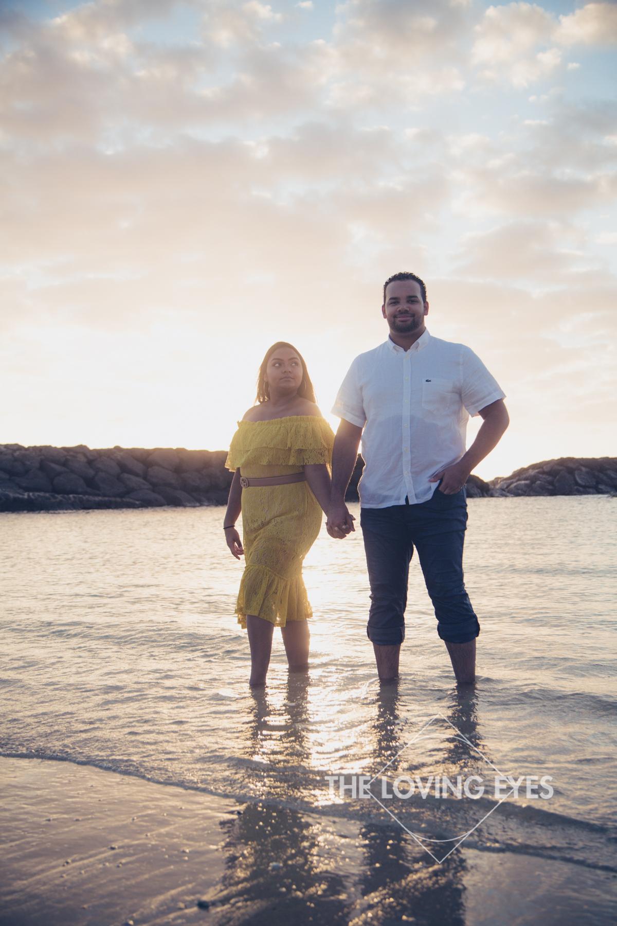 Romantic Hawaii engagement photo during sunset at Ala Moana Beach Park