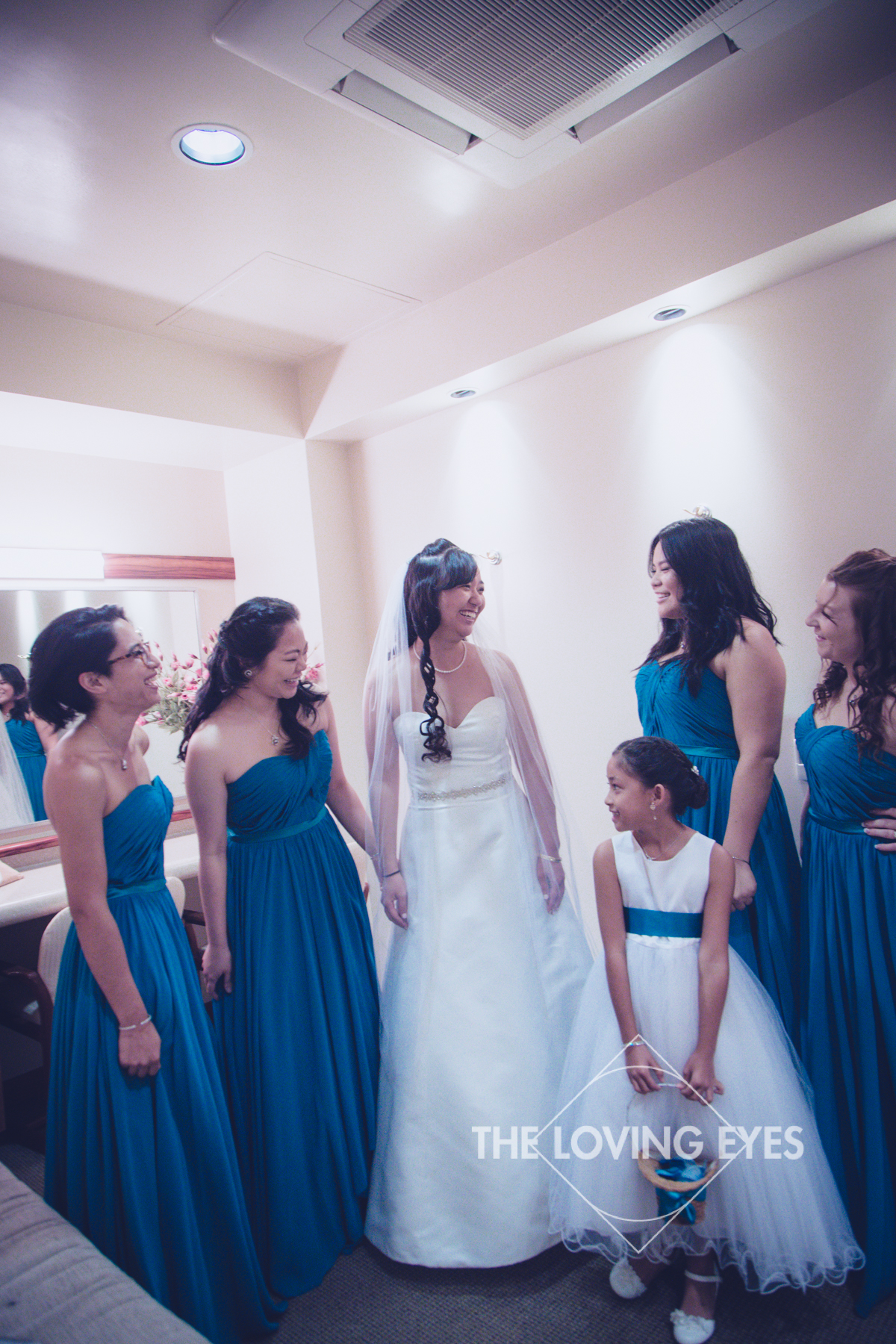 Bride getting ready with her bridesmaids in Bishop Memorial Chapel bridal suite
