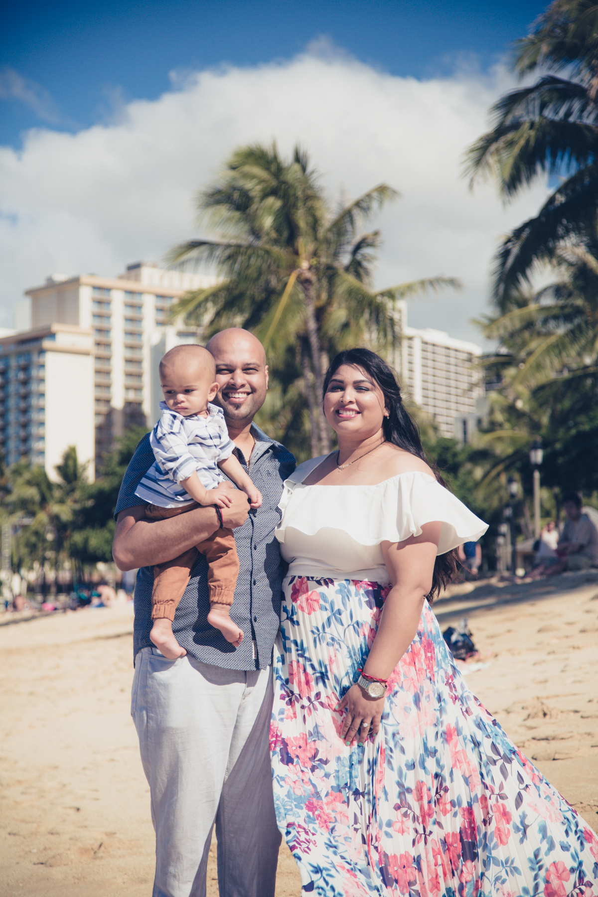 Family vacation photo on the beach in Waikiki