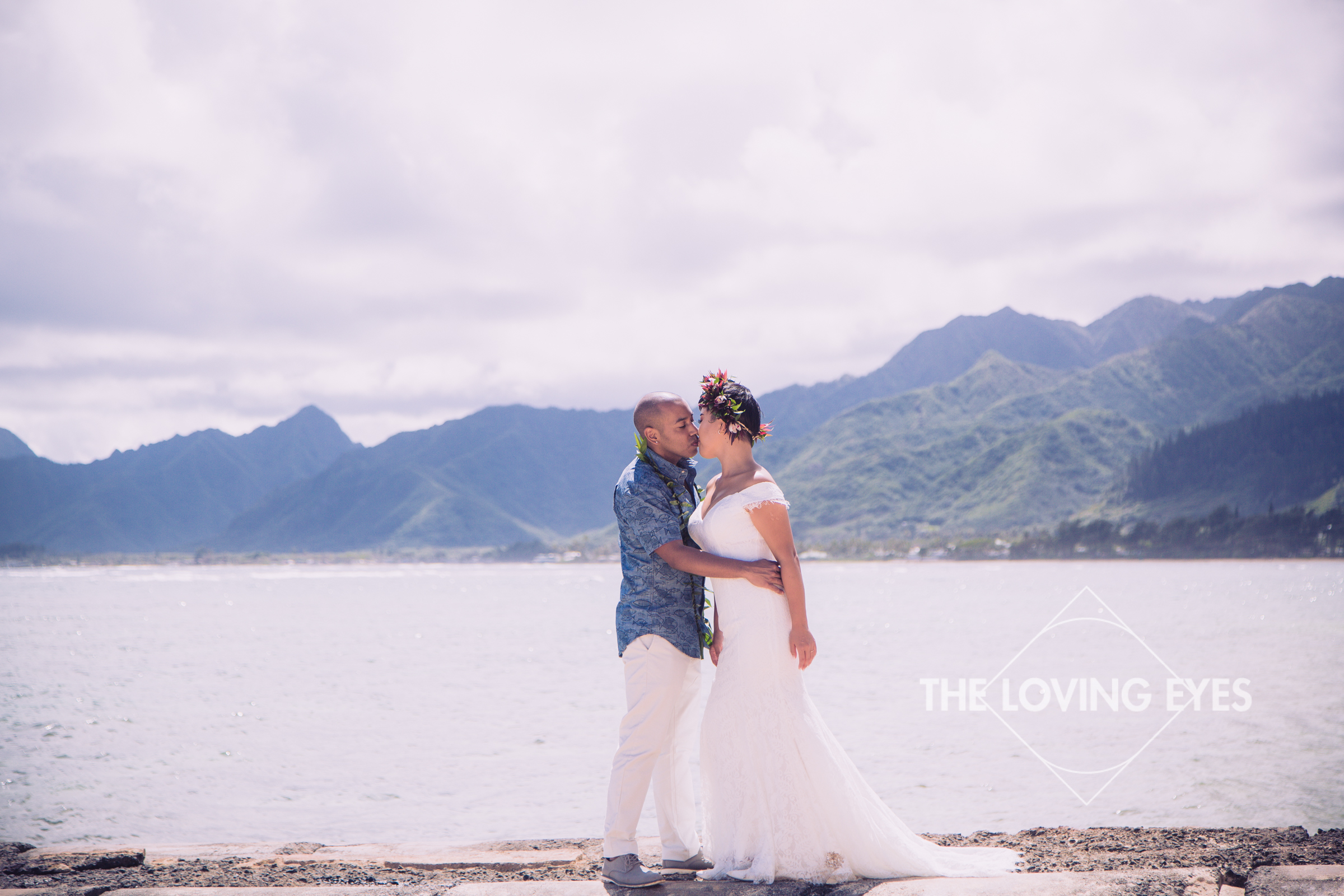 Romantic bride and groom portrait on the beach at the Tiki Moon Villas in Hawaii