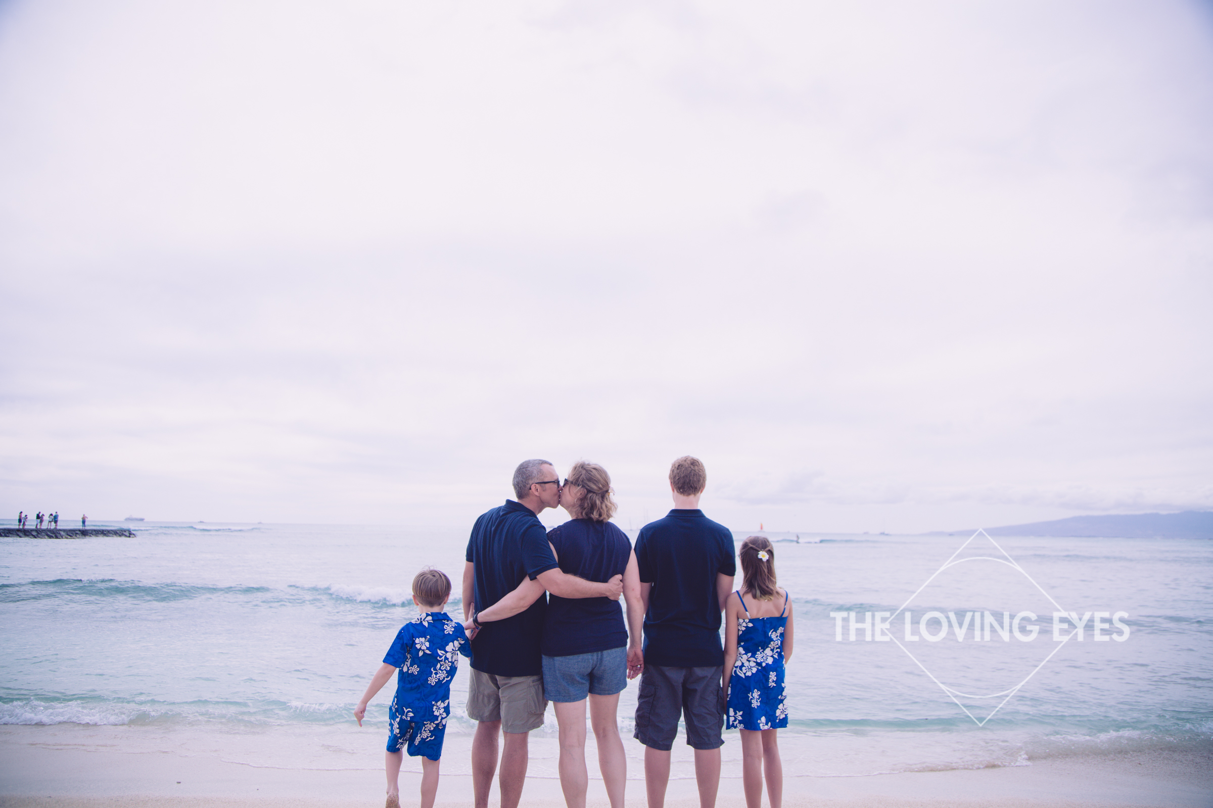Family vacation photo on the beach in Waikiki Hawaii