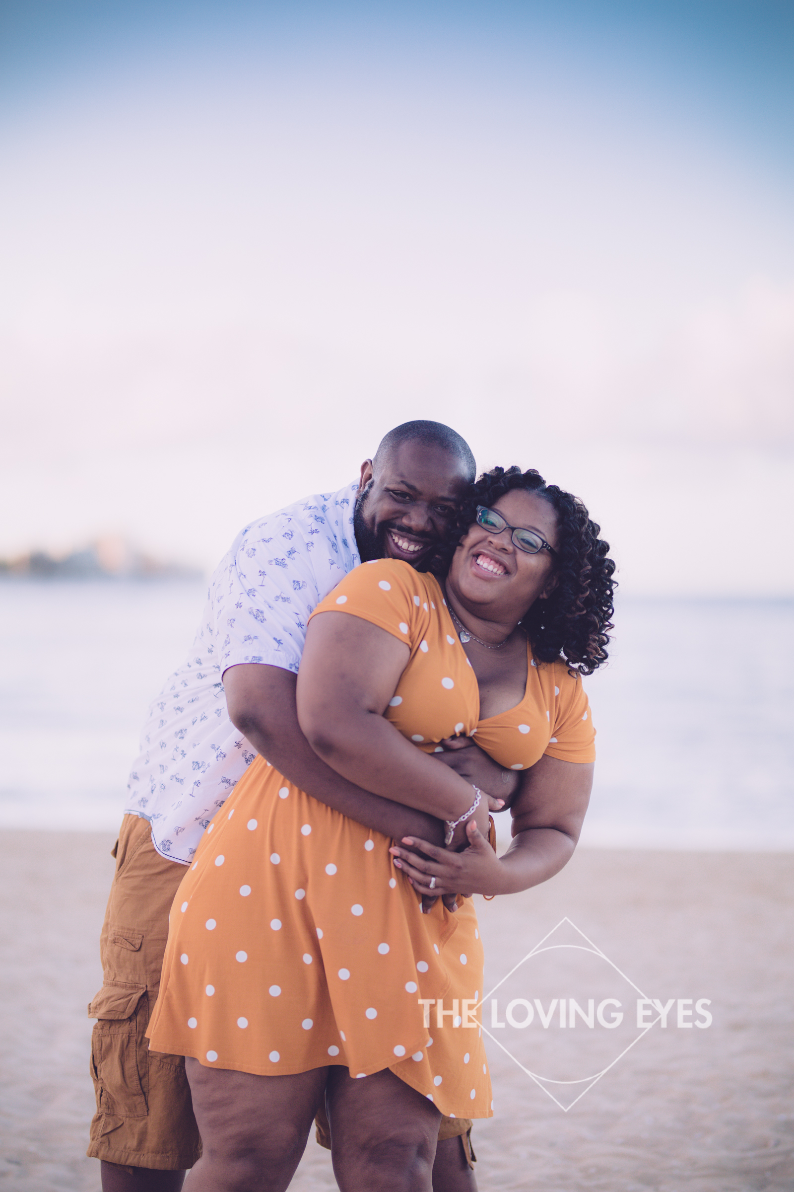 Fun married couple photo during vacation on the beach in Waikiki