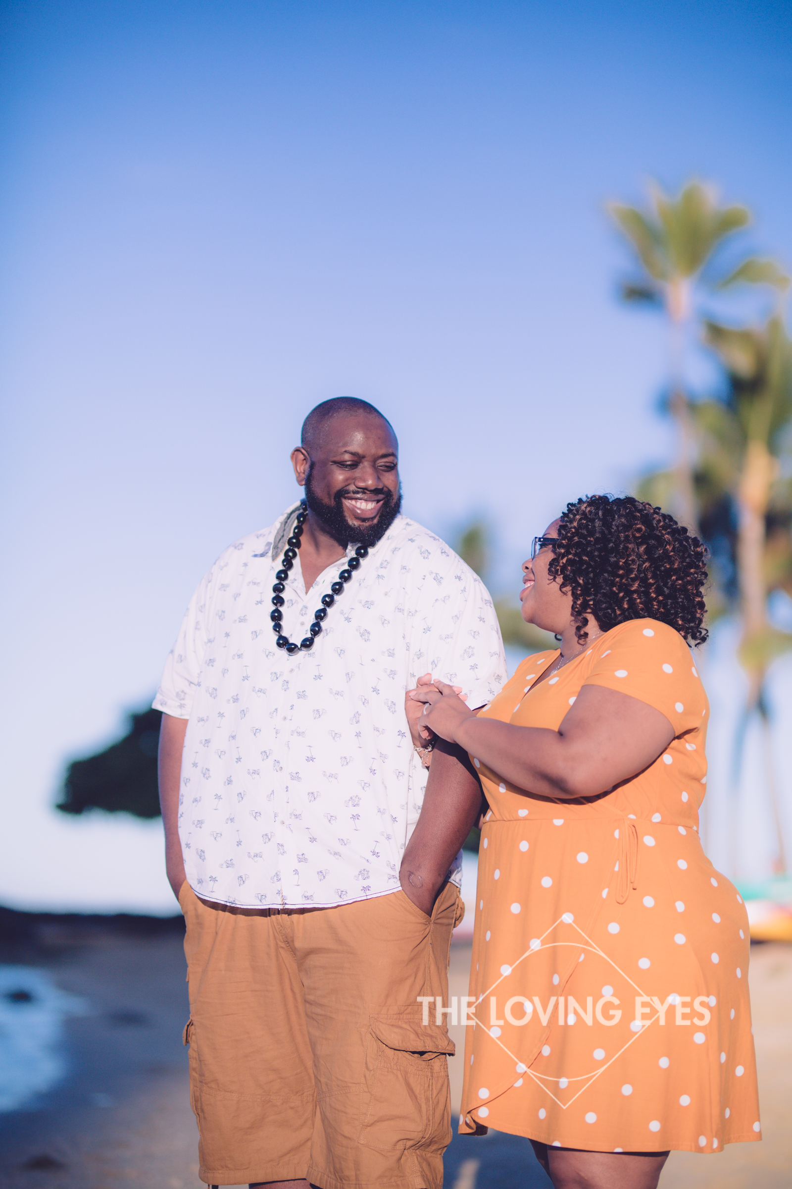 married couple photo during vacation on the beach in Waikiki
