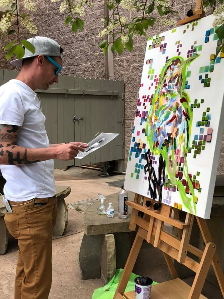 Painting on the Riverwalk at Aspen & Evergreen Gallery.