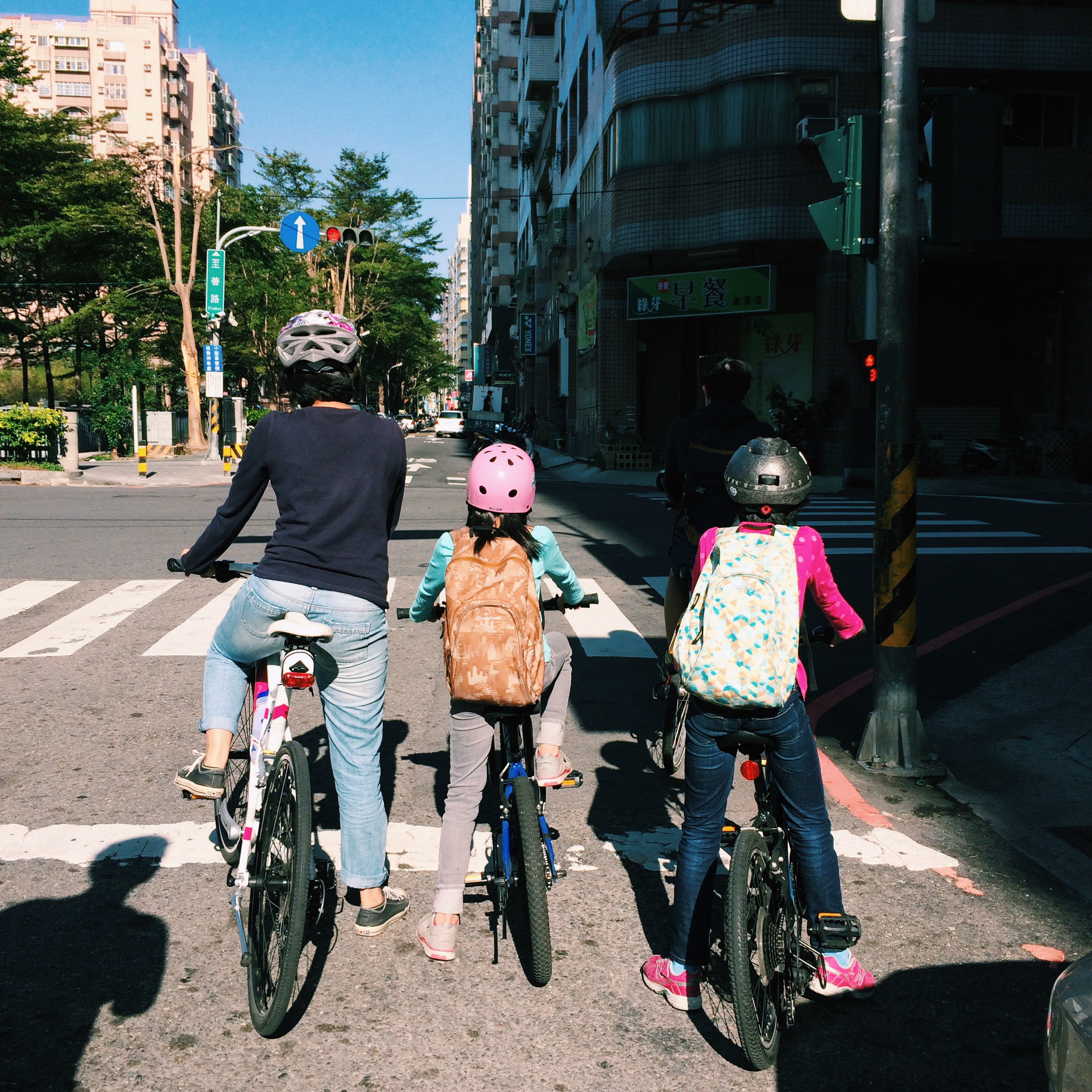 A mum riding bikes with her two daughters