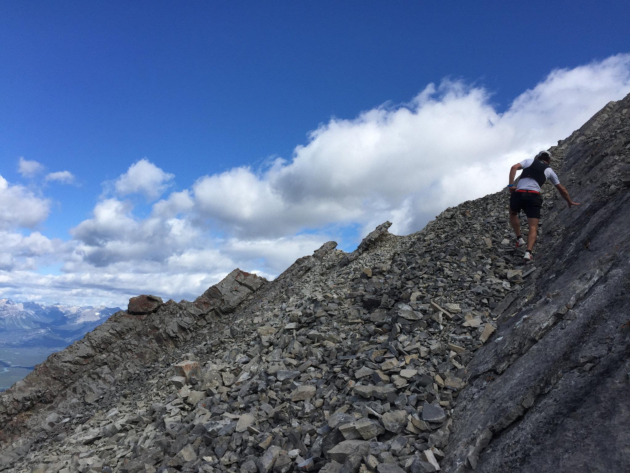 Adam scrambles to the ridge on Lady Mac