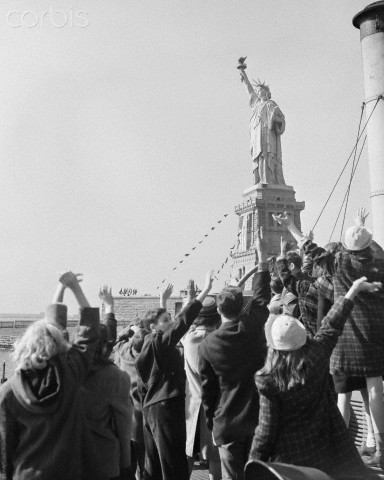 Immigrants greet the Statue of Liberty. (As an immigrant myself,I was filled with similar awe when I first saw the Twin Towers (and every time thereafter, in fact).)