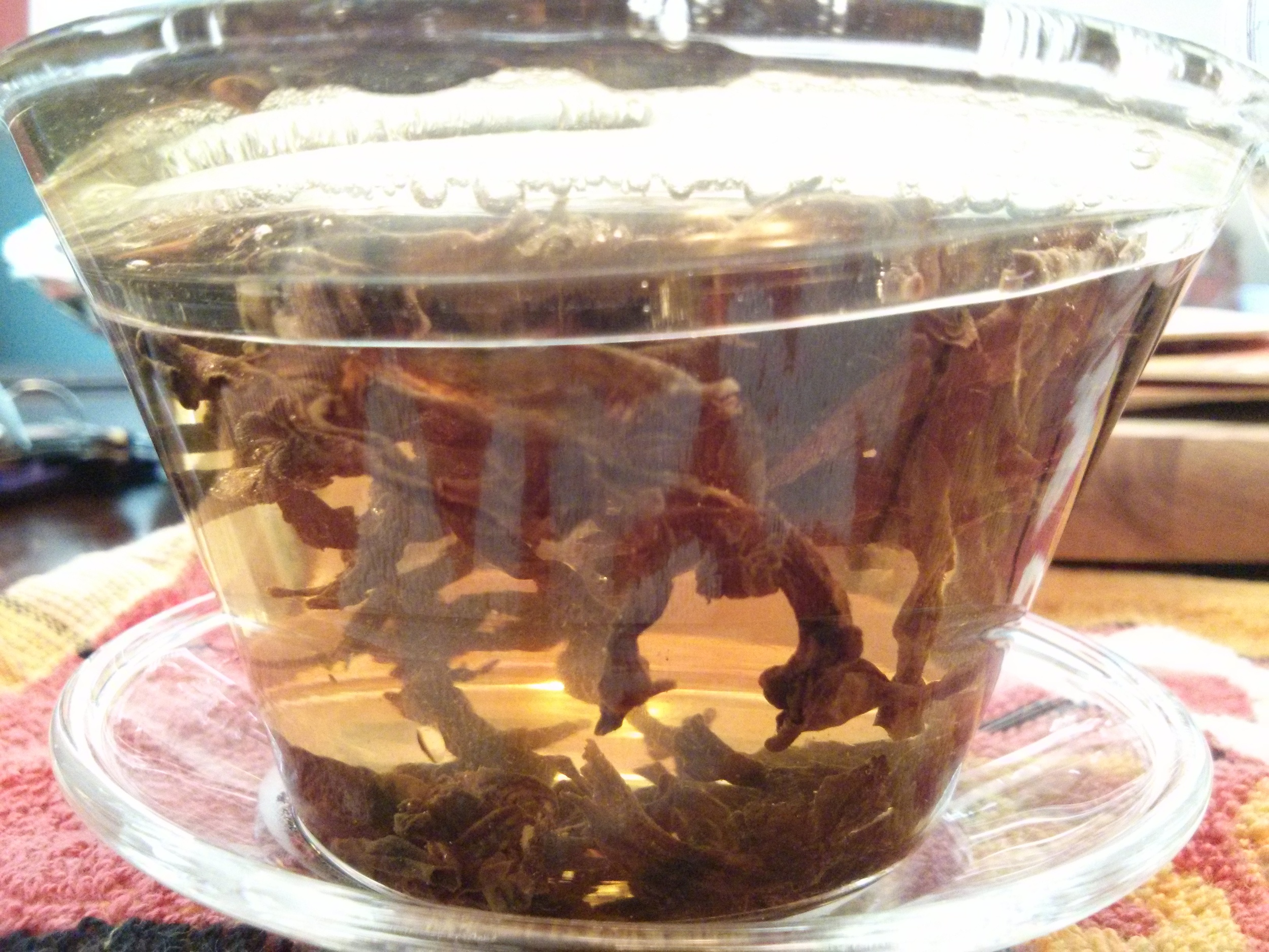 Like other Rock Oolongs, this tea is roasted, though not as thoroughly as the Tie Luo Han, allowing the smell to be sweeter.  This tea was infused for 45 seconds at 190F water several times, each cup yielding a full flavor.
