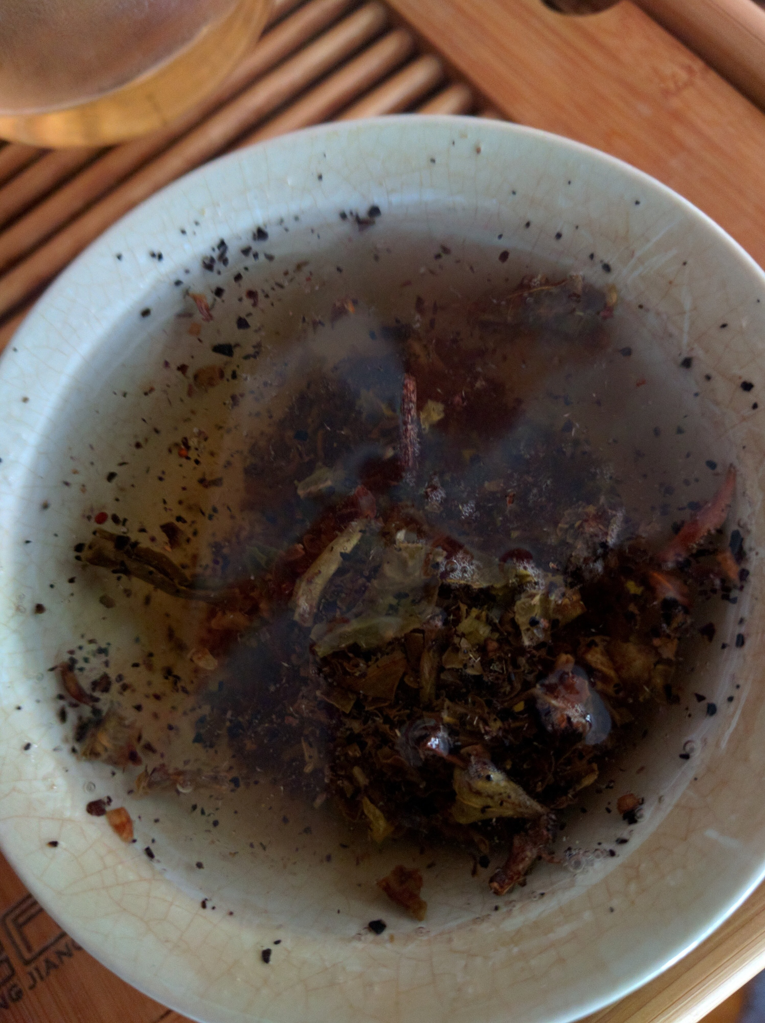 This tea has a lot of broken bits that even through a wash and several infusions are still present.