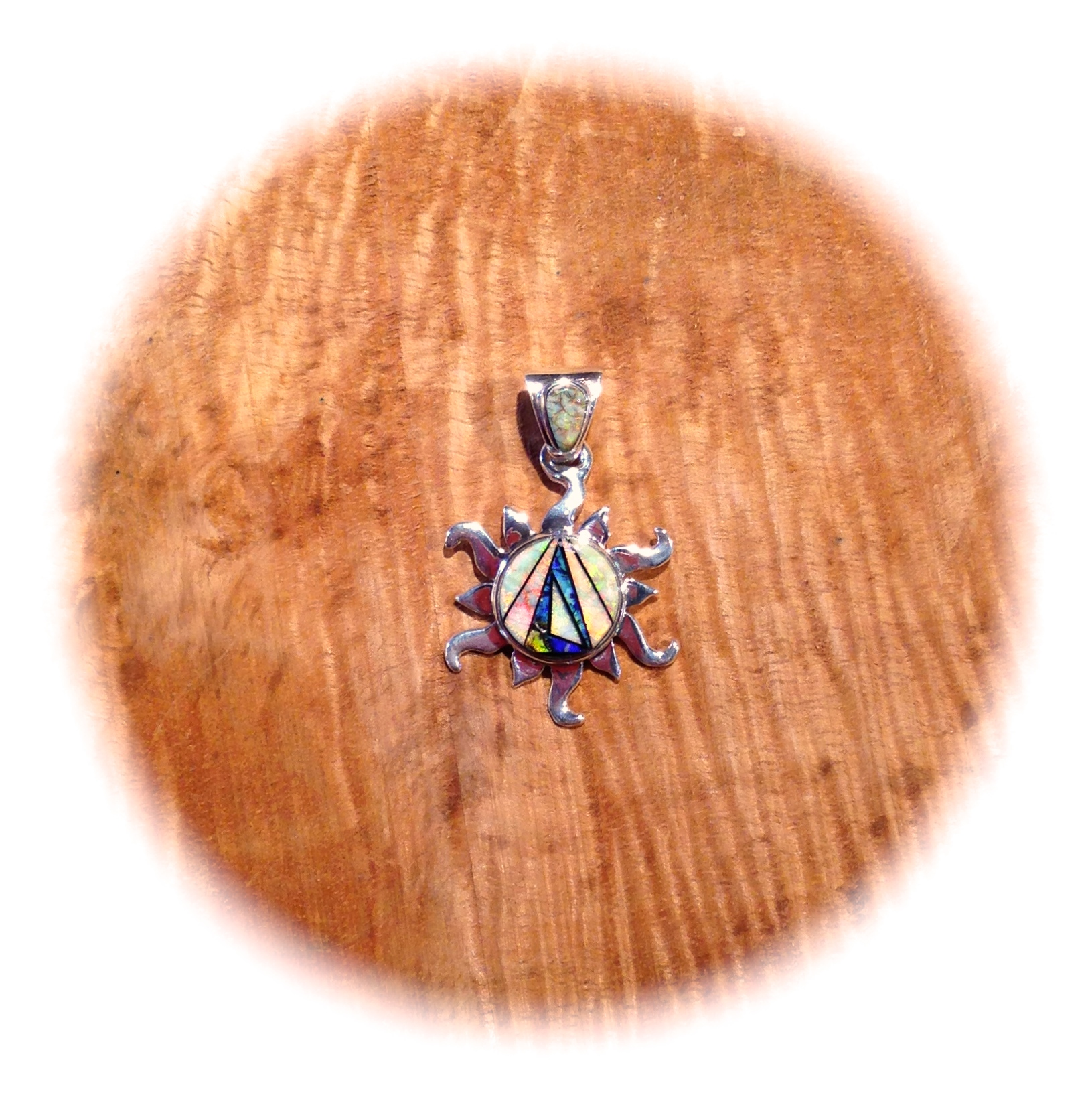 CULTURED OPAL AND ONYX SMALL SUN PENDANT BY CALVIN BEGAY