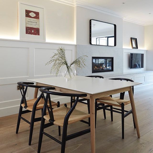 Wishbone chairs from @cadesign.ie sitting pretty in the dining area of our D6 basement kitchen against our bespoke panelling with concealed lighting #interiordesign #midcenturymodern #bespokecabinetry #irishdesign #homedesign #basementkitchen #bespokefurnituredesign #ledlights