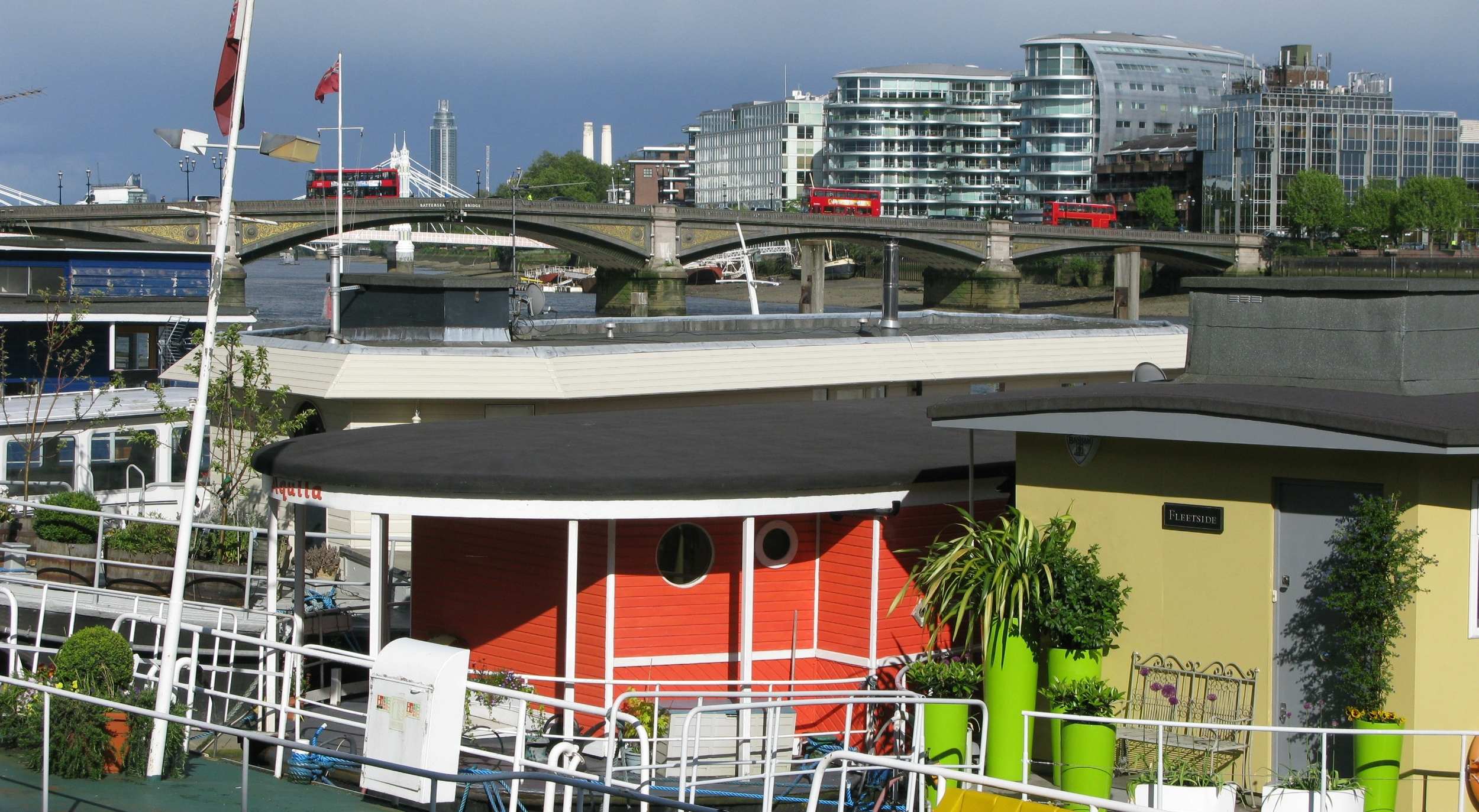 Rows of house boats along the Thames near the Chelsea Flower Show