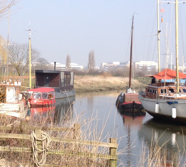 A serene site on the River Stour,Sandwich,behind are the remains from an over ambitious pharmatucial company promising the earthdelivering little .