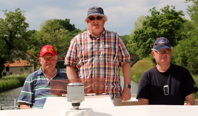 Three wise men navigating a French Canal in pursuit of wine,food andhappiness ( our great friend K on the right)