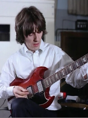 George Harrison with his 1964 SG Standard during the Hey Bulldog sessions.